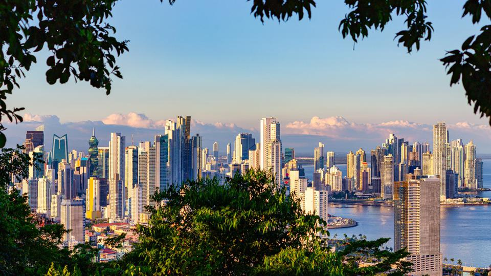 View of the skyline of Panama City framed by tropical rain forest