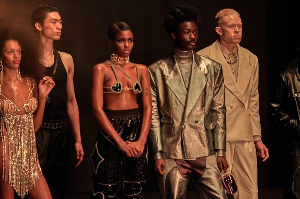 five models wearing flashy designs for GCDS during Milan Fashion Week