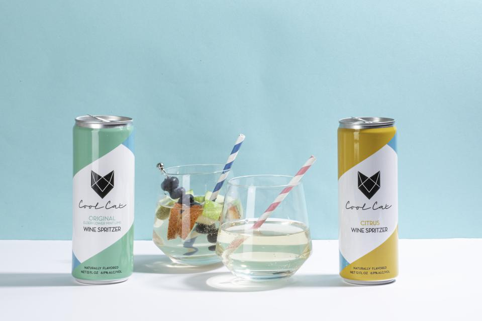 Cool Cats Wine Spritzer in glass with straws and berries