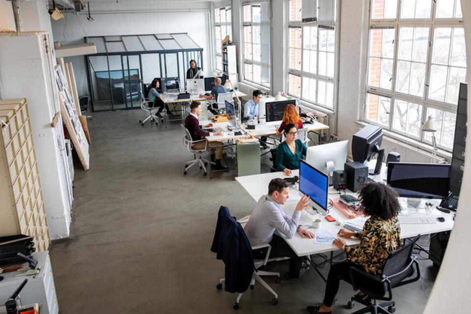 Large office space with people working