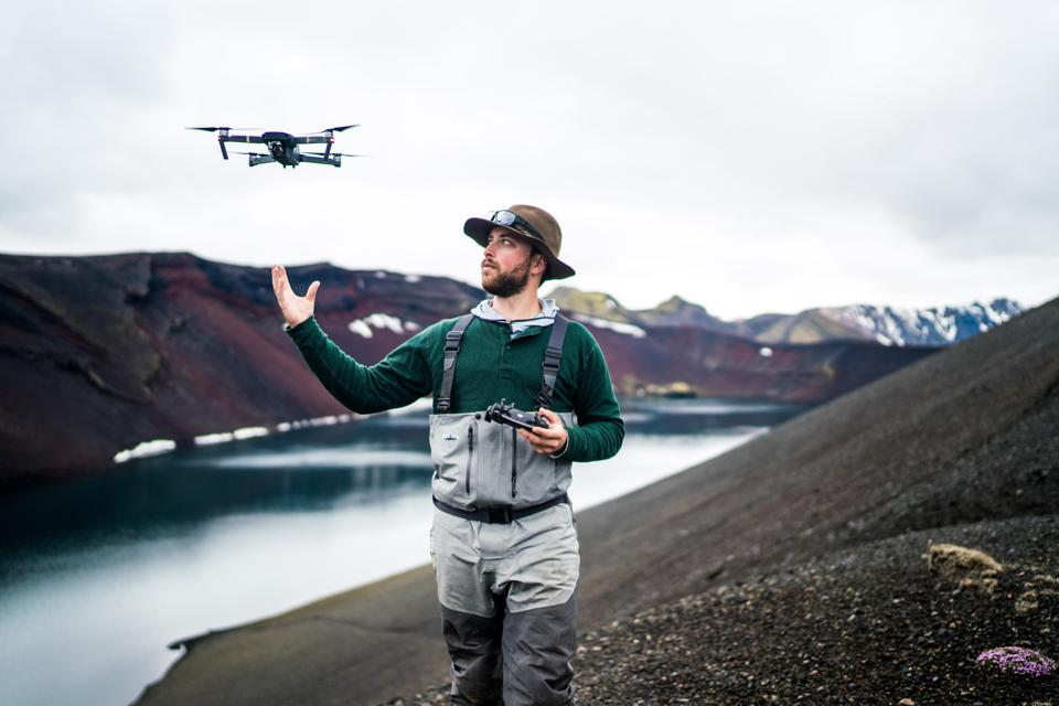 Jared Zissu with a drone in Iceland