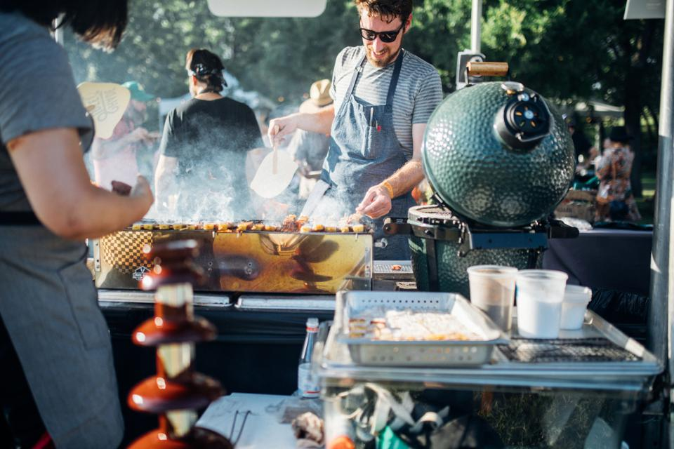 Chefs cooking outdoors on grills