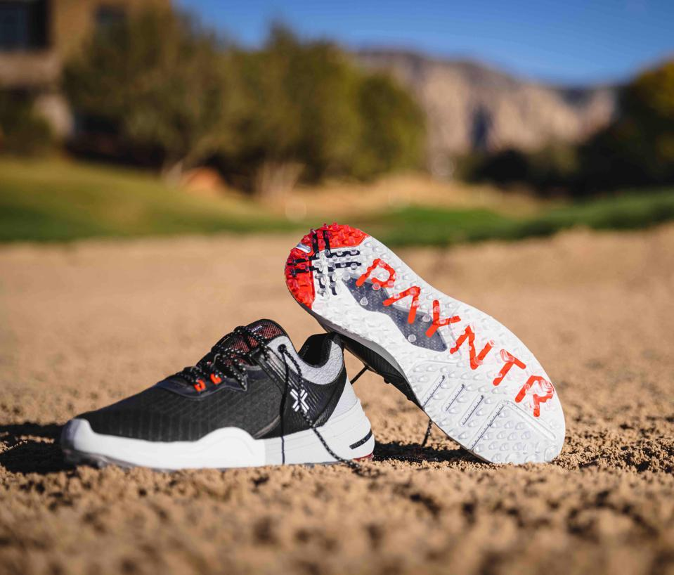 A pair of Payntr golf shoes