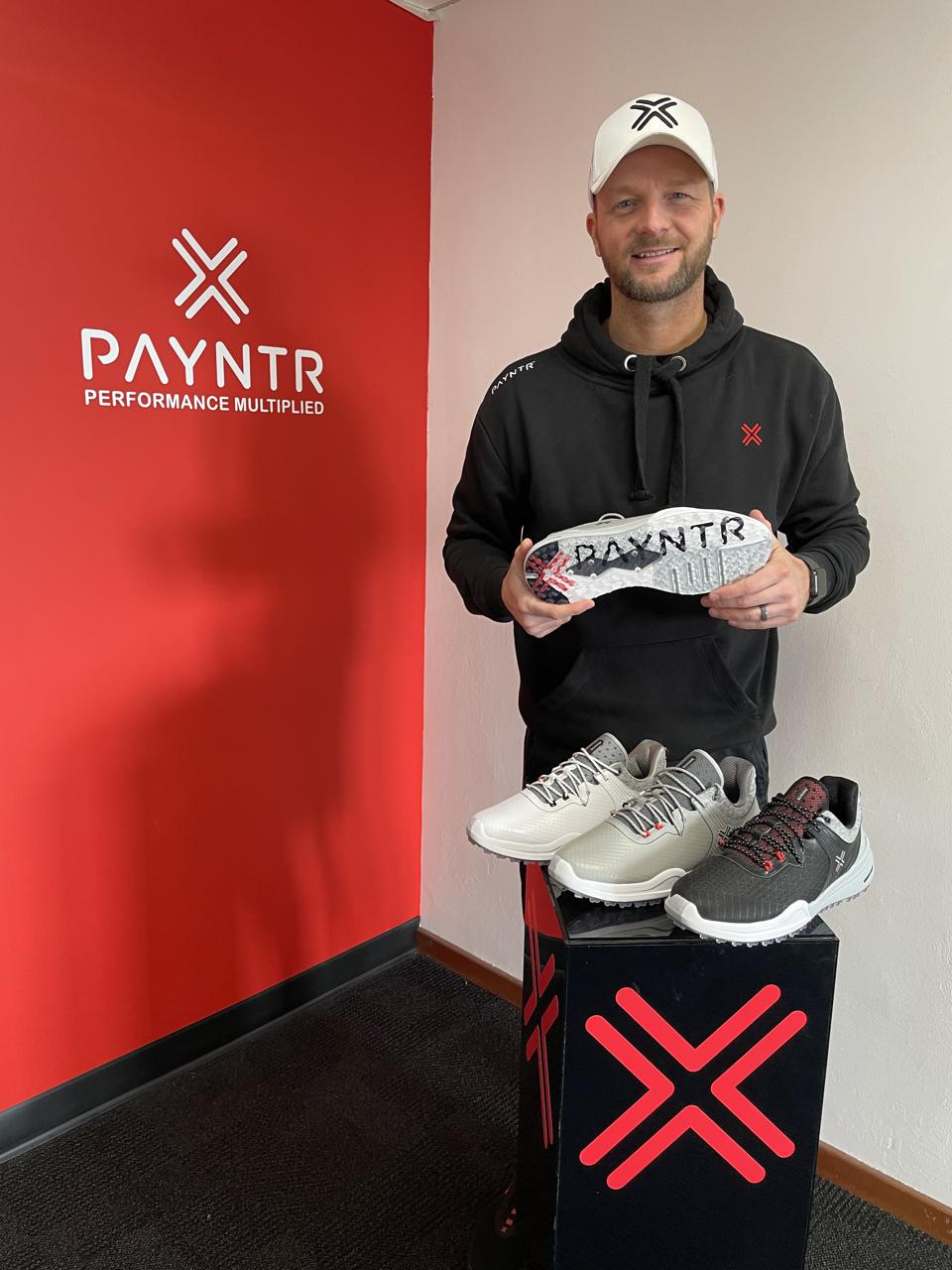 David Payntr holds his company's debut golf shoe