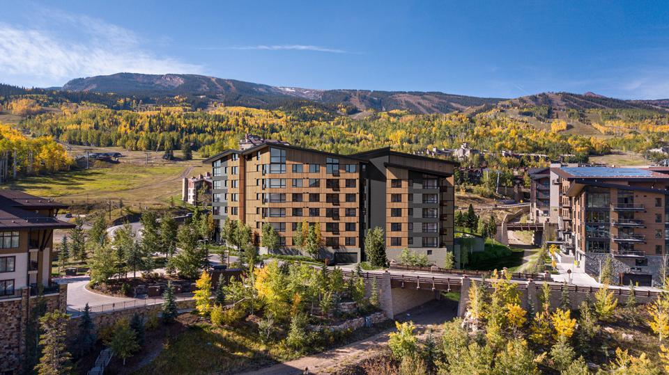 mountains behind electric pass lodge new development snowmass base village colorado