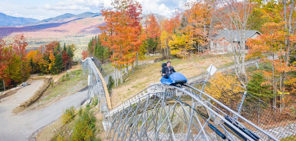 A mountain coaster through the Adirondacks with fall foliage.