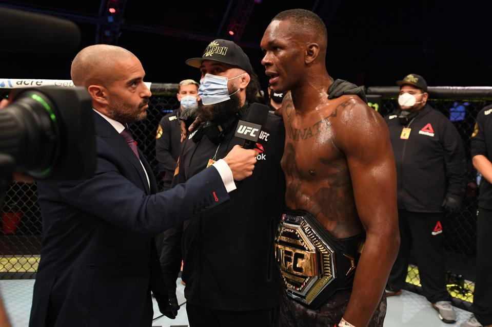 UFC middleweight champion Israel Adesanya looks to become a two-division champion when he faces light heavyweight titleholder Jan Blachowicz at UFC 259