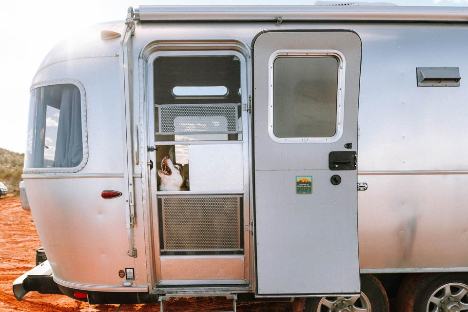 An Airstream and its dog sport a carbon-neutral decal