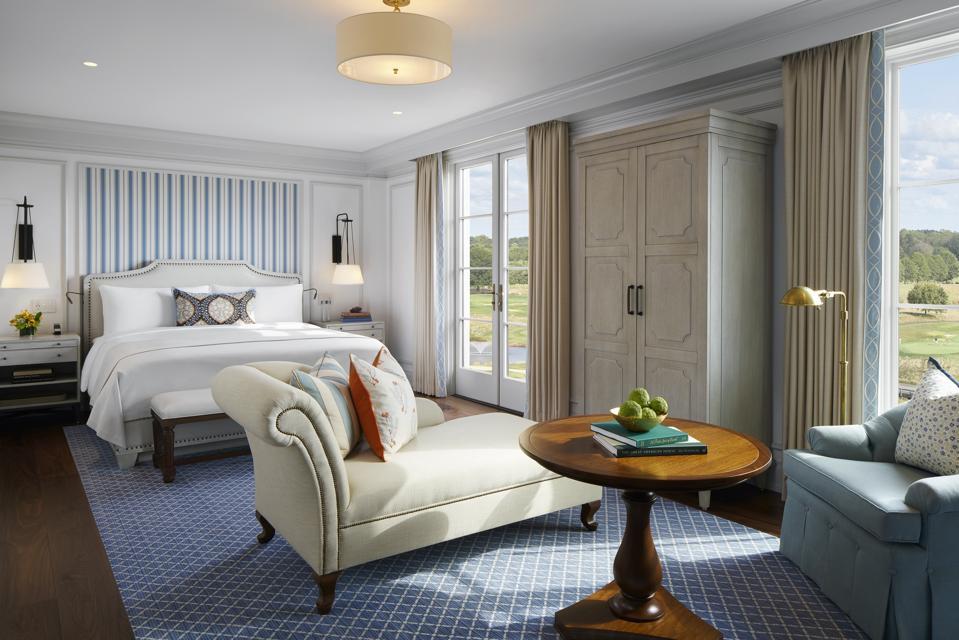 A blue, contemporary hotel bedroom