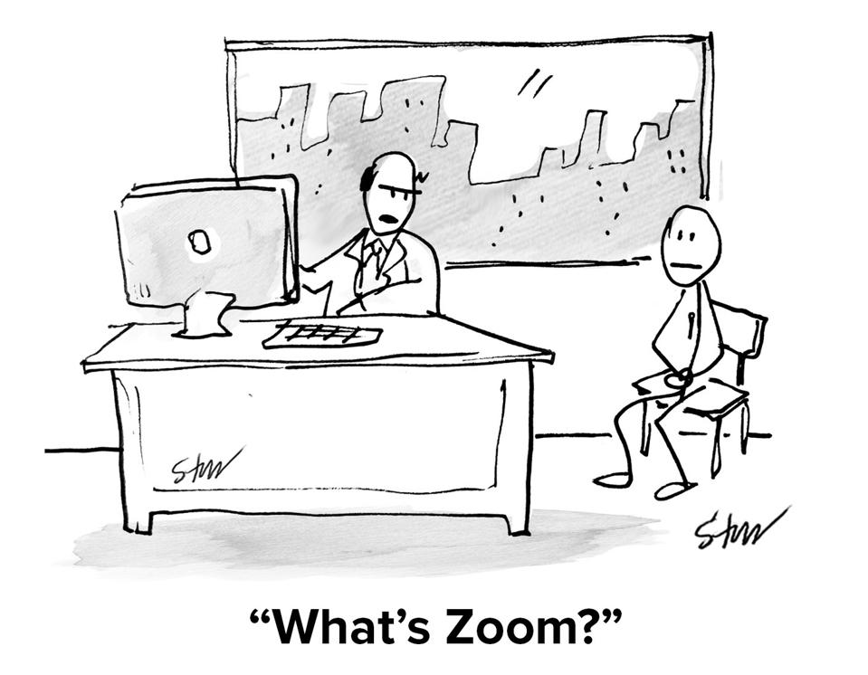 A man at his office desk on his computer asking his assistant ″What's Zoom?″