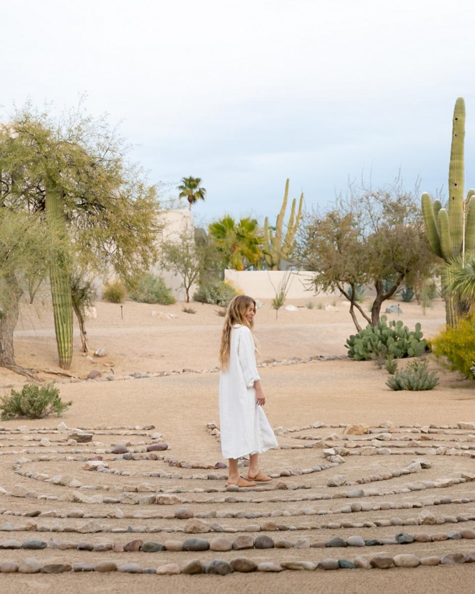 A woman walks among the stones as a form of meditation, CIVANA Wellness Resort and Spa, Carefree, AZ