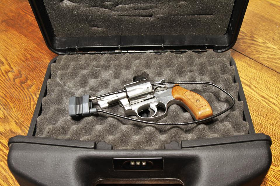 Revolver with a cable lock in an open case