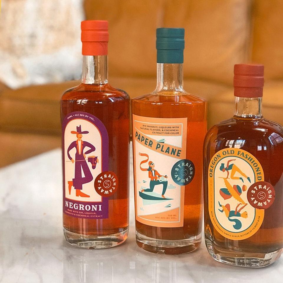 Bottles of Straightaway Negroni, Paper Plane and Oregon Old Fashioned bottled cocktails