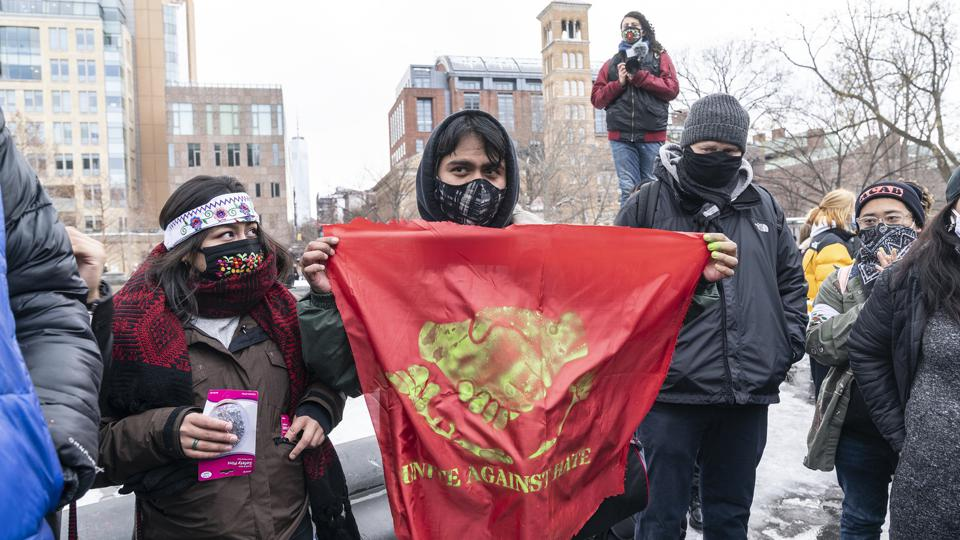 More than 200 people gathered on Washington Square Park to...