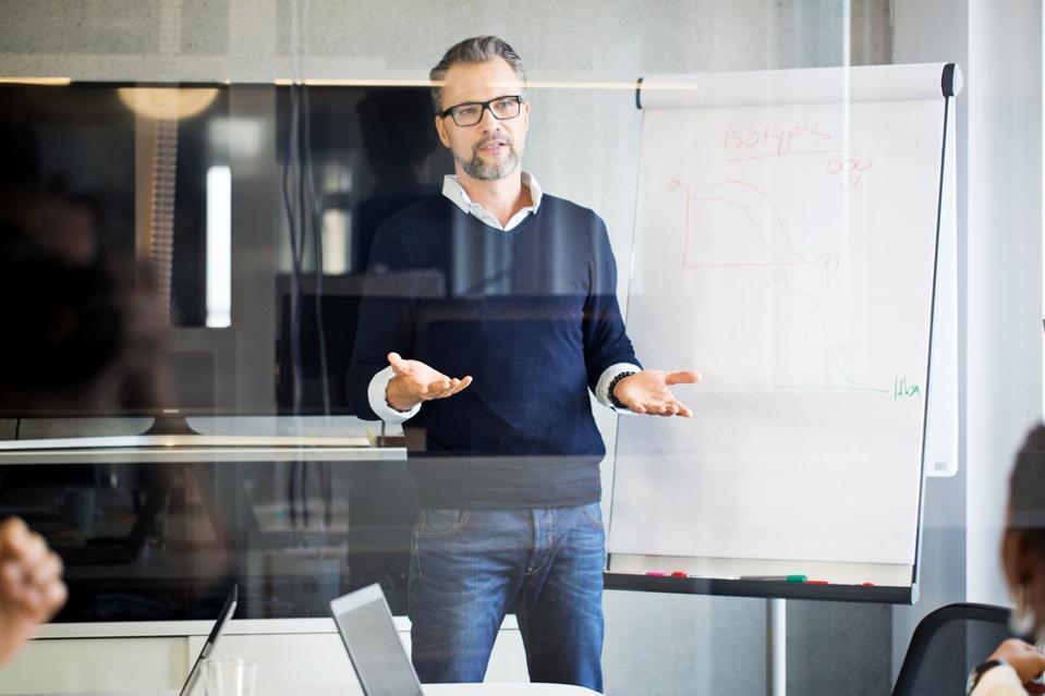 Mature businessman giving presentation