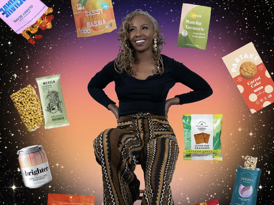 Tometi sits on a stool surrounded by snacks floating in space.
