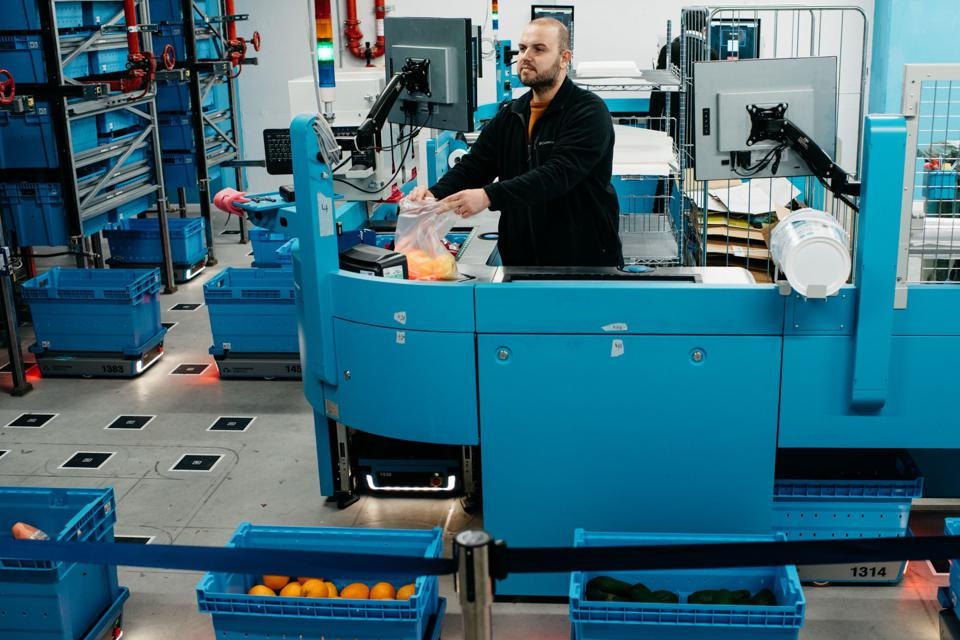 A worker preparing a grocery order at a Fabric micro-fulfillment center in Tel Aviv.