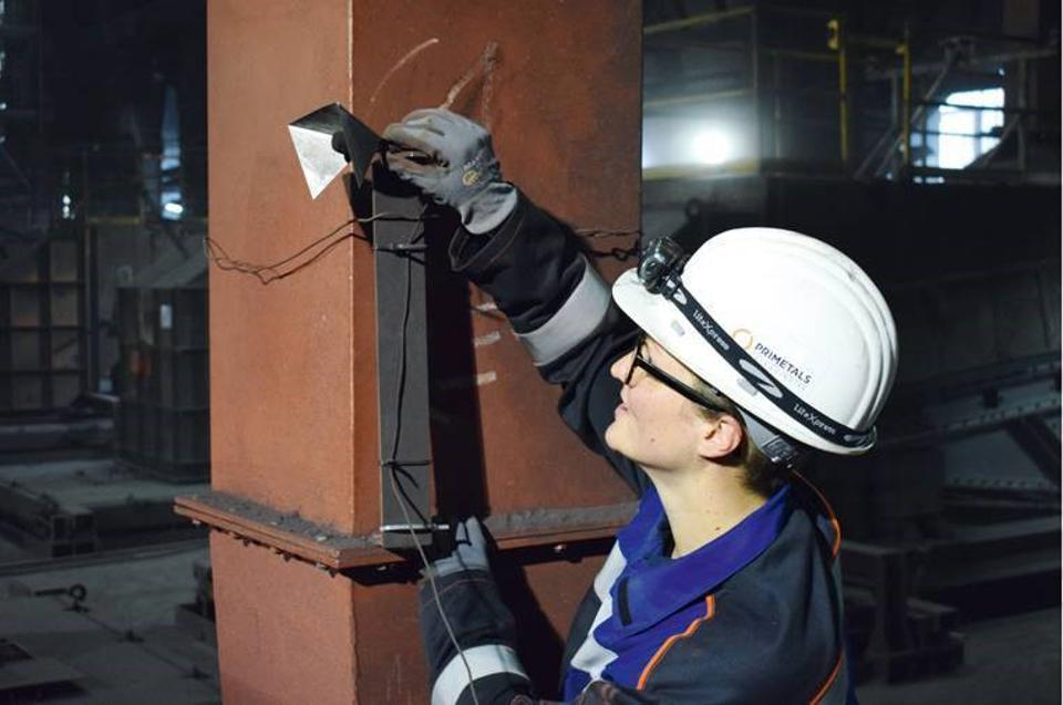 Mayrhofer, pictured working with Primetals' Acoustic Expert system. It analyzes audio and other data to evaluate the inner workings of a steel plant.