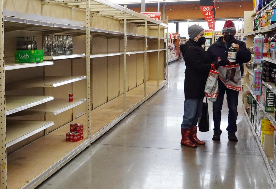 AUSTIN, TEXAS - FEBRUARY 18: People stock up on necessities at the H-E-B grocery store on February 18, 2021 in Austin, Texas; note the empty water bottle shelf. (Photo by Joe Raedle/Getty Images)