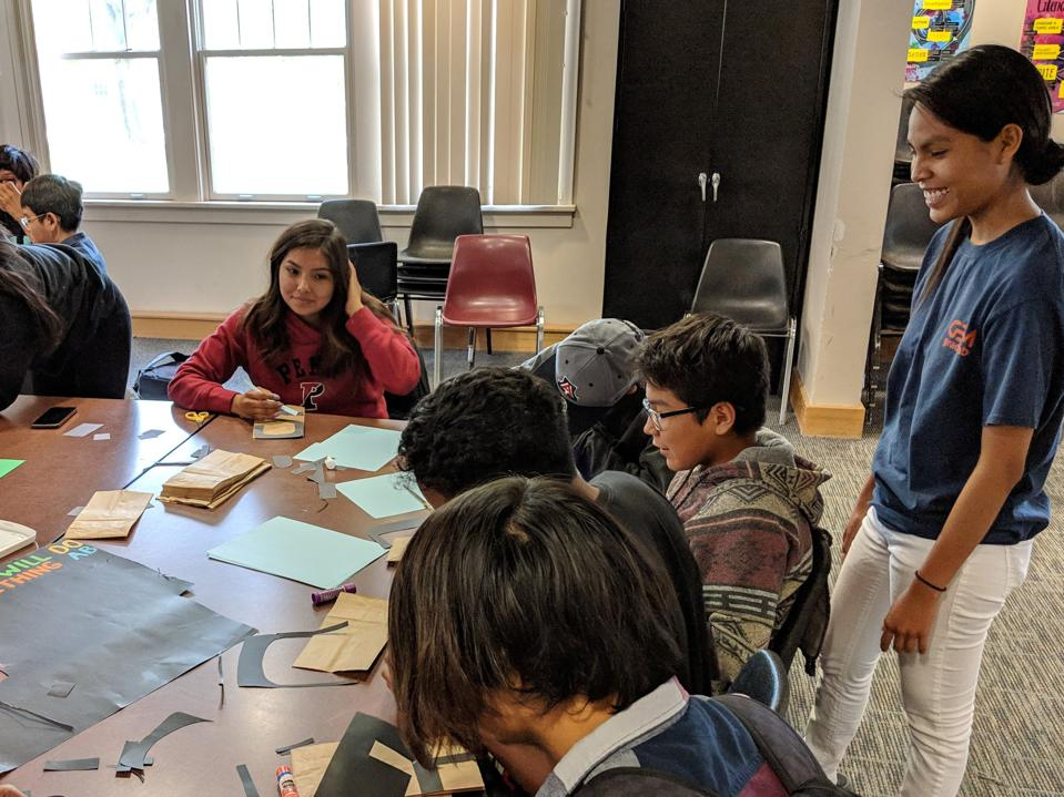 A group of indigenous youth working on math activities.