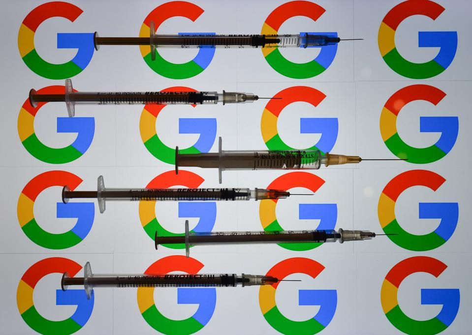 Syringes in front of Google logos.