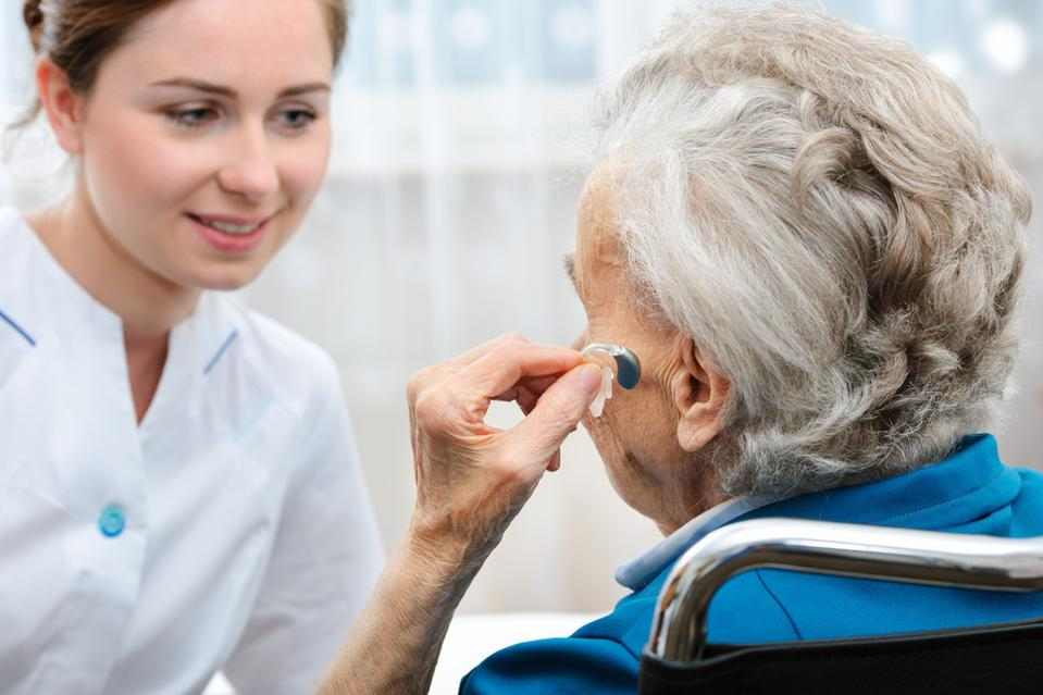 Senior woman with a hearing aid