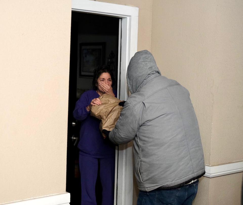 A Houston resident reacts to WCK's founder Chef José Andrés delivering meals to her home.