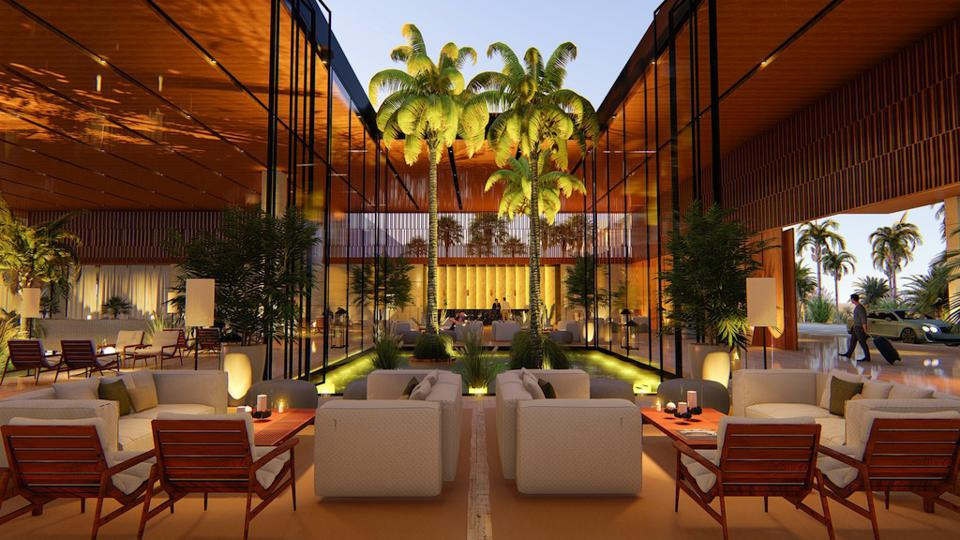 A beautiful, open-air lobby studded with palm trees, a central water feature, and intimate seating areas.