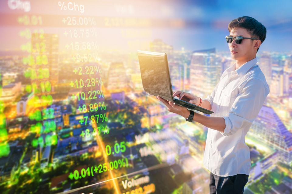 Business analysis stockmarket with digital tablet  with skyscaper background
