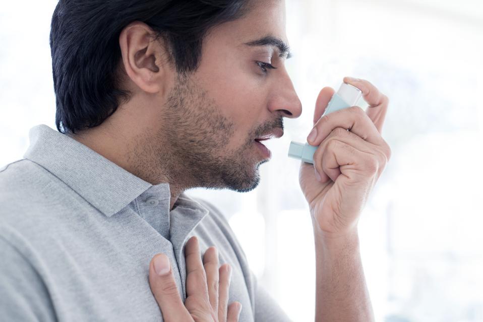 Man using inhaler