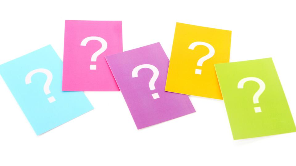 Five colored rectangular cards each with a white question mark