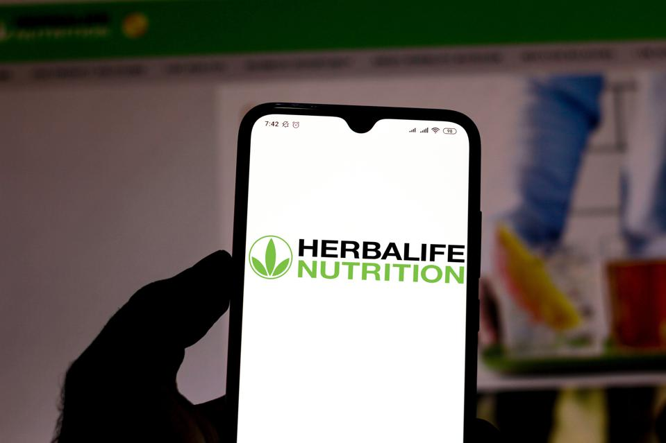In this photo illustration the Herbalife logo is seen...