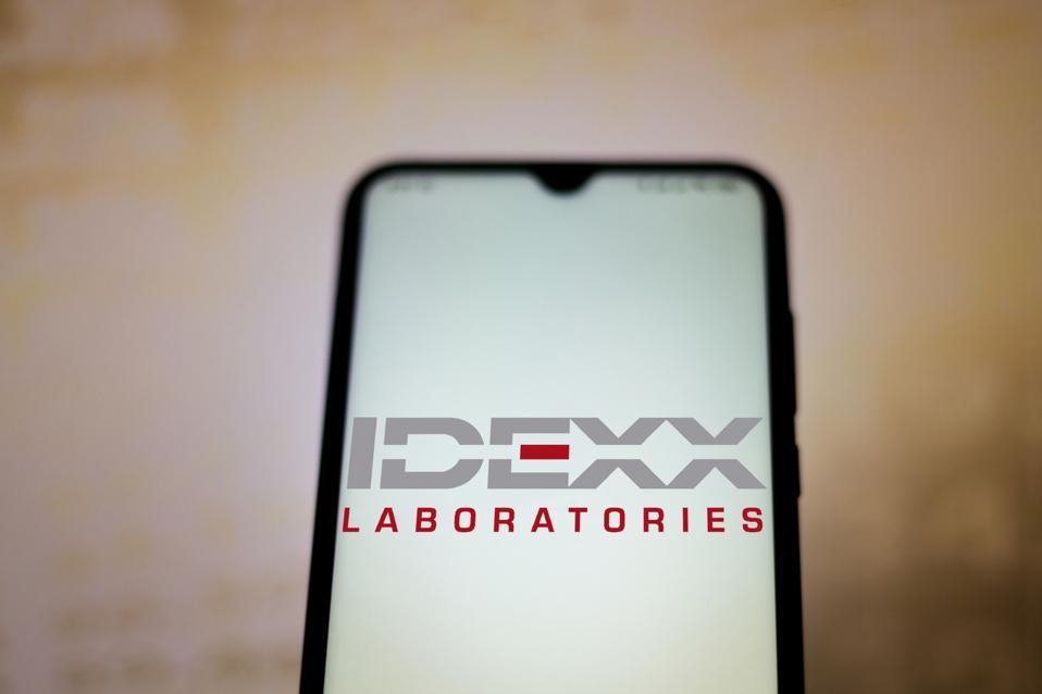 In this photo illustration the IDEXX Laboratories logo seen...