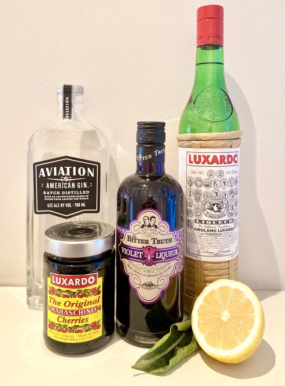 Aviation Ingredients: Aviation Gin; The Bitter Truth Violet Liqueur; Luxardo Marachino Liqueur; Lemon Juice; and Luxardo Marachino Cherry