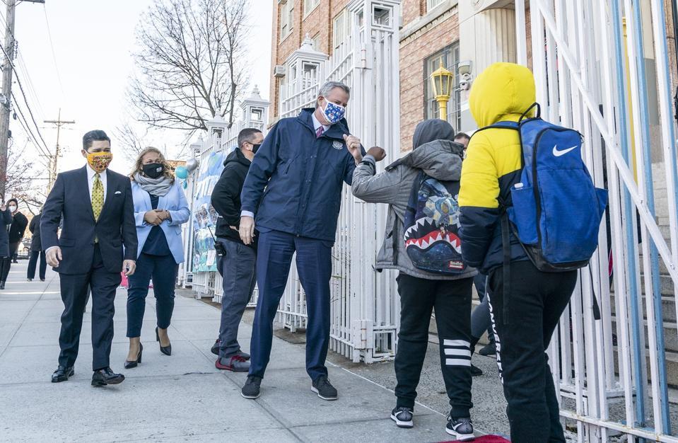 Mayor Bill de Blasio greets students during visit of Bronx...
