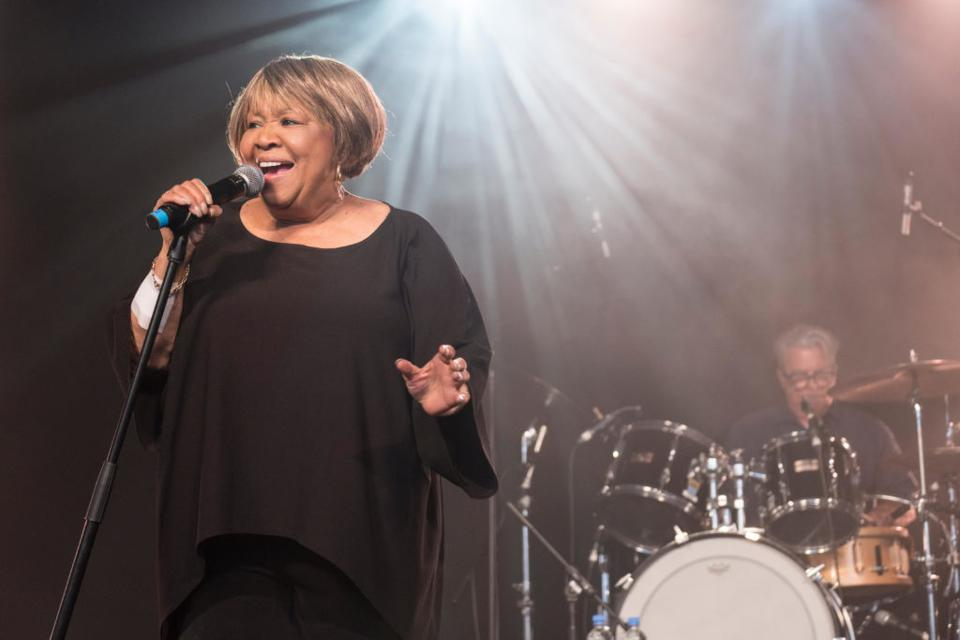 Mavis Staples singing, drums in the background