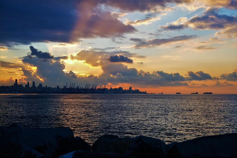 The skyline of Beirut, Lebanon, captured at sunset.