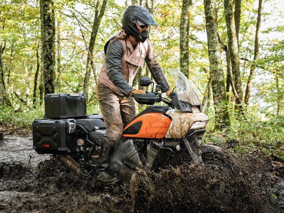 Harley-Davidson Pan America being ridden through a mud puddle