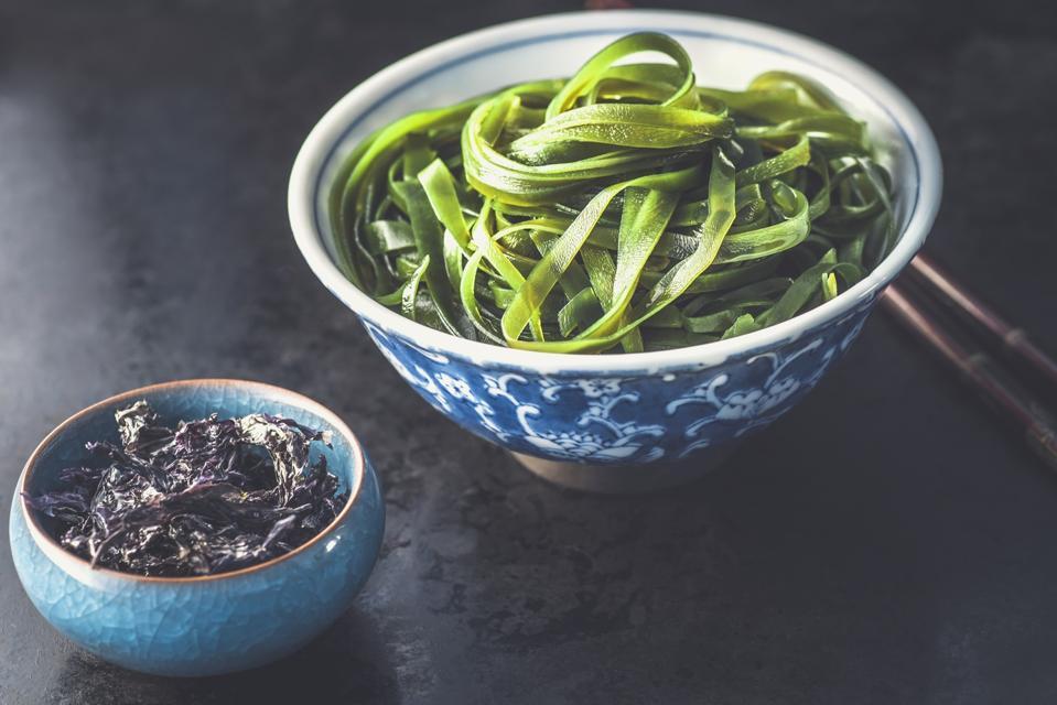 Various type seaweeds, nori and wakame seaweed on the black background, sea vegetables. Healthy Snack, Korean or Japanese food