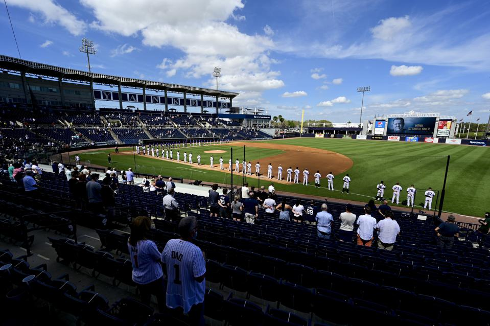 Fans attend a spring training ball game between Yankees and Blue Jays