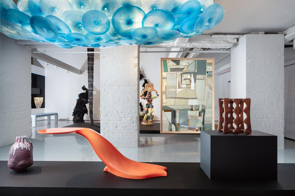 Exhibition view of Objects: USA at R & Company, featuring works by Adam Silverman, Wendell Castle, Jeff Zimmerman, Art Carpenter, Kiva Motnyk, and others.