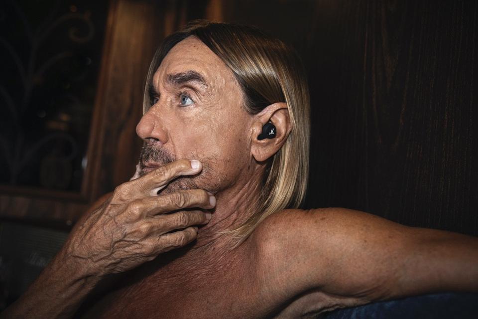 Iggy Pop wearing Marshal Mode II earbuds