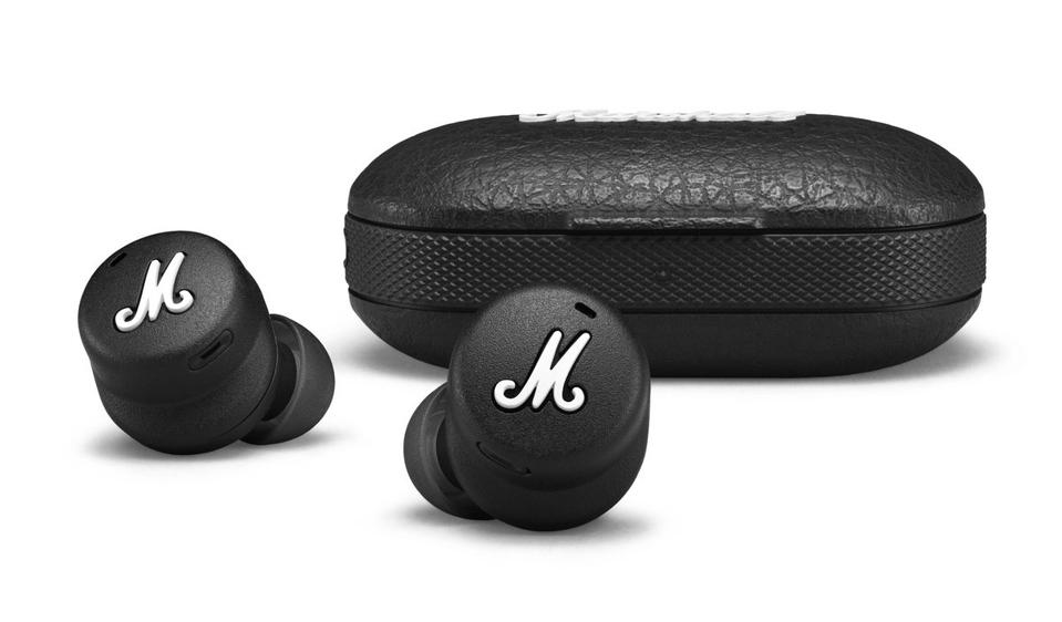 Marshall Mode II earbuds in front of charging case