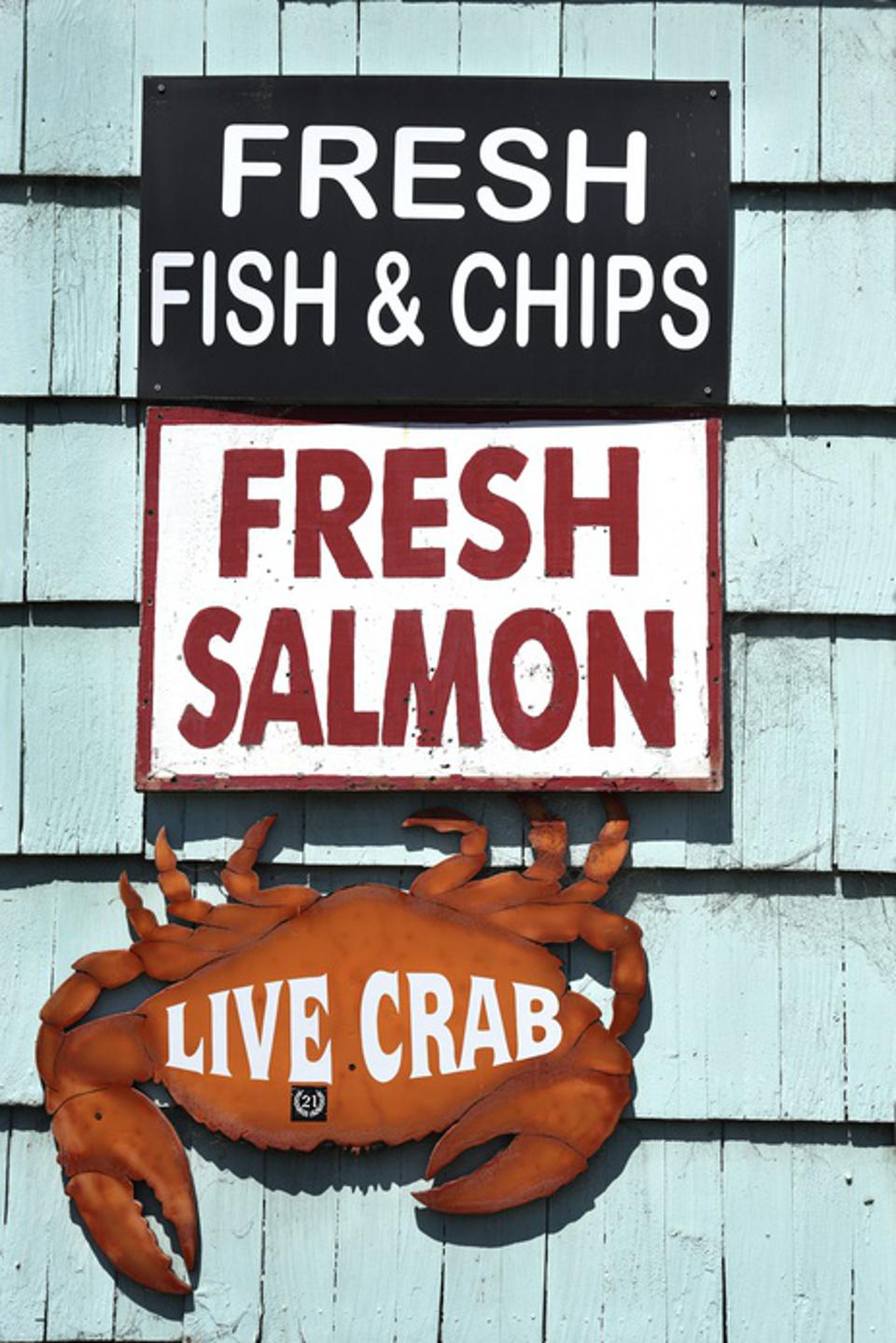 Restaurant sign advertises its seafood products