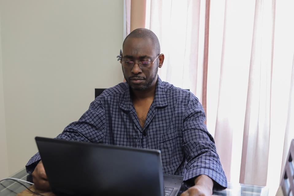 Portrait Of Man Using A Laptop