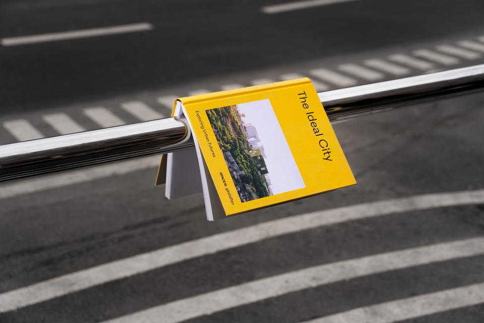 New book The Ideal City over a road.