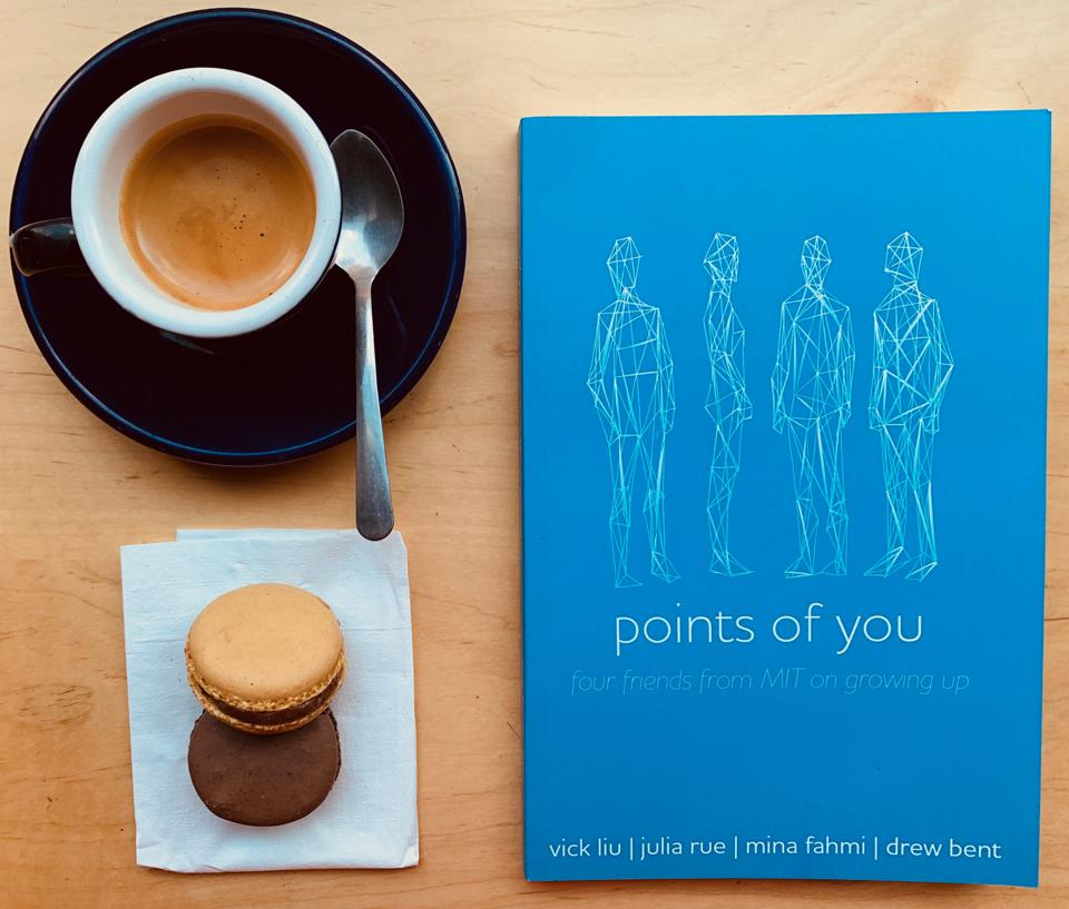 A copy of Points of You next to a cup of coffee and a biscuit.