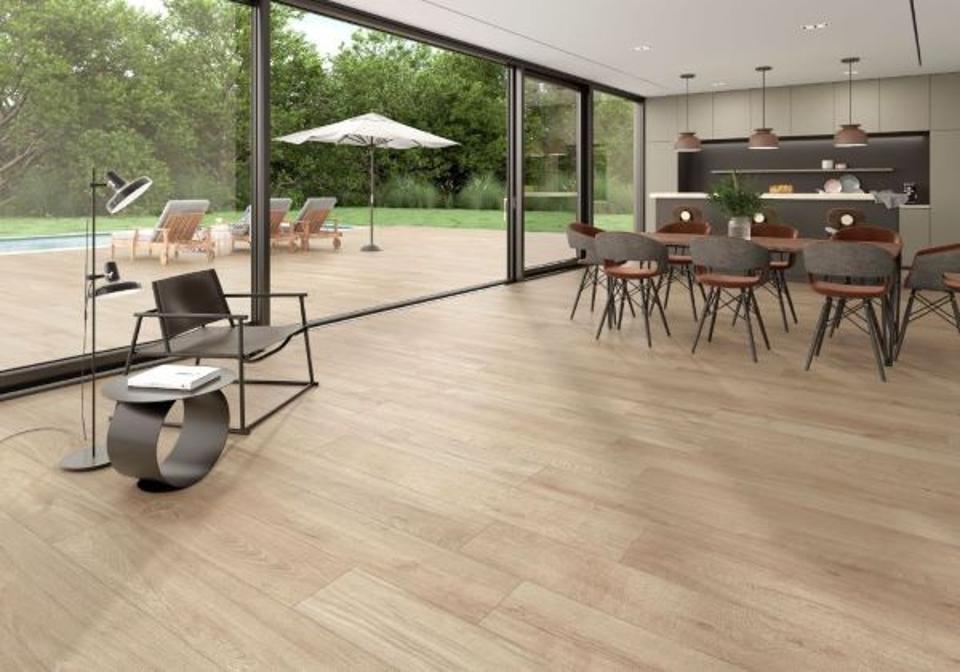 Indoor-outdoor rooms with wood-look floor tile.