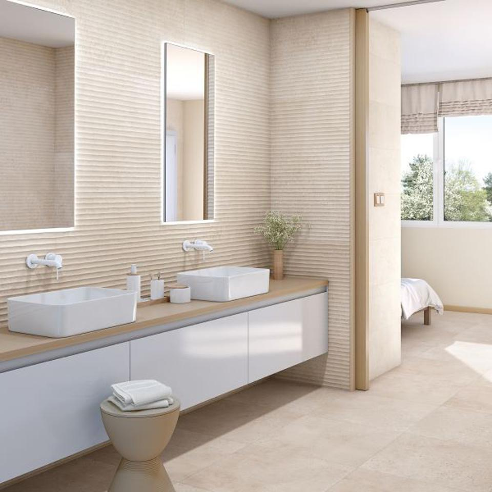 Textured sand wall tile in a bathroom.