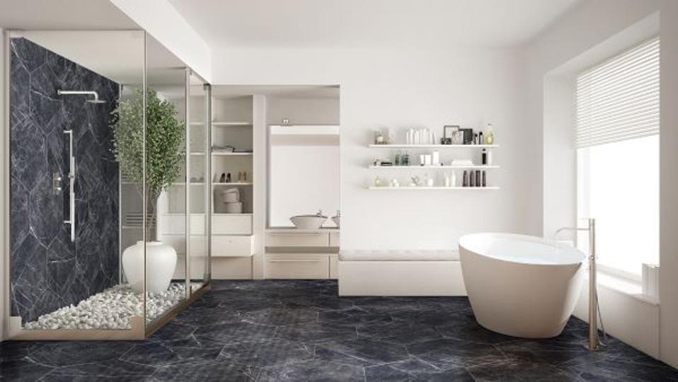Blue hexagonal floor and wall tiles in a bathroom.
